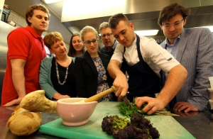 (Image: Samuel Woods, Jacqueline Pankhurst, Samantha Ellis, Lydia Harris, Andy Hook, Daniel Duggan and Giles Gasper preparing one of the Medieval dishes; Credit: Durham University)