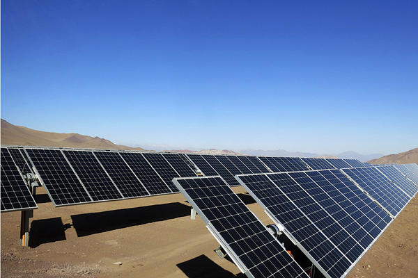 Solar panels of local mining company CAP are seen in the Atacama Desert, June 5, 2014. To power Earth with just solar energy, there would need to be enough solar panels to fill 25,000 square miles, or an area about the size of West Virginia.