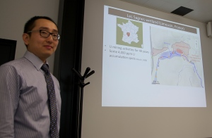 Dr. Wang explaining his research to Jacqueline Schindler